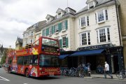 CitySightseeing tour bus outside Blackwells bookstore